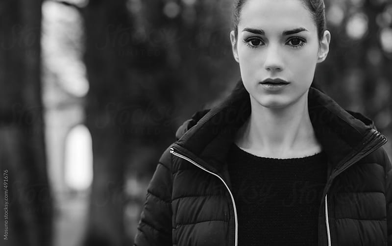 Beautiful Woman Posing in the Park  by Mosuno for Stocksy United