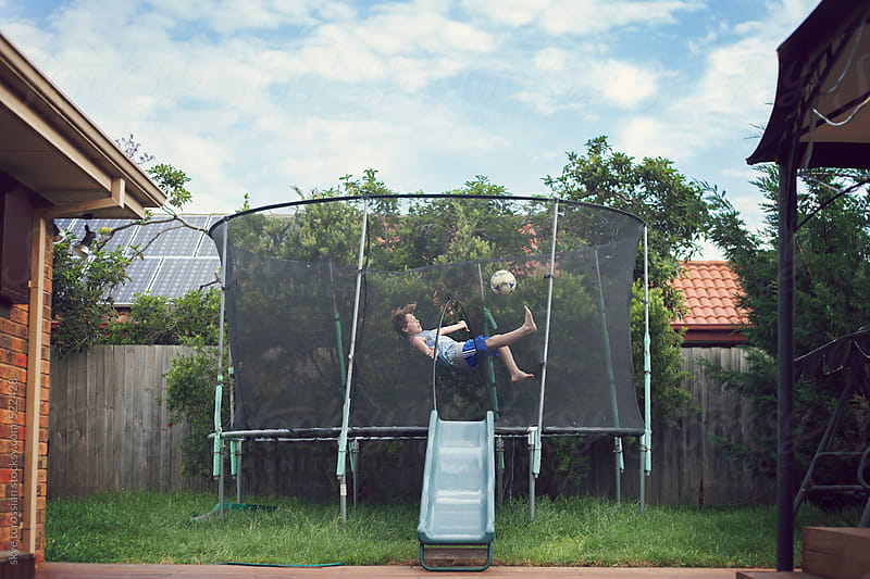 Soccer moves on the trampoline by skye torossian for Stocksy United