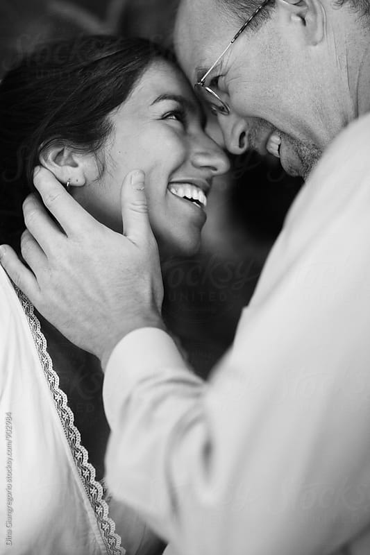 Couple Smiling Faces Touching Together by Dina Giangregorio for Stocksy United