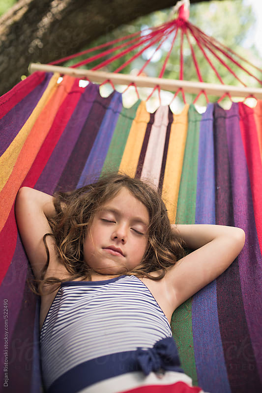 Little girl resting in hammock by Dejan Ristovski for Stocksy United