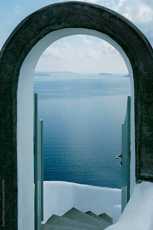 Archway with view through to the sea by Paul Phillips for Stocksy United