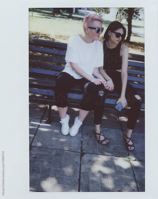 lesbian couple on the street by Alexey Kuzma for Stocksy United