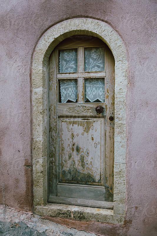 Old door in monemvasia island, Greece. by Alberto Bogo for Stocksy United