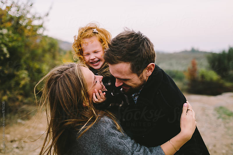 Family embracing closeup by Evgenij Yulkin for Stocksy United