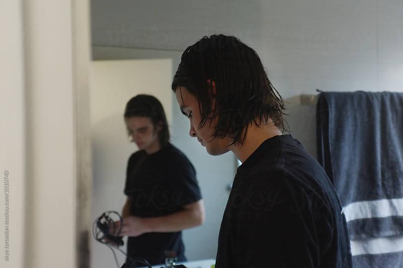 Teen boy getting ready by skye torossian for Stocksy United