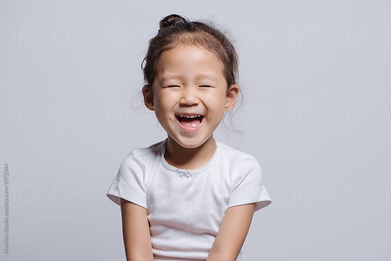 Studio shot of young Asian girl by MaaHoo Studio for Stocksy United