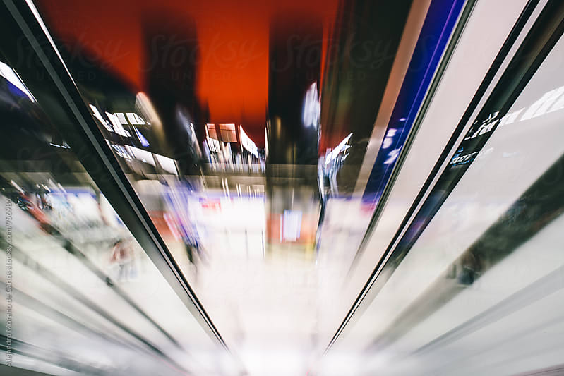 Abstract motion blurred view on an escalator by Alejandro Moreno de Carlos for Stocksy United