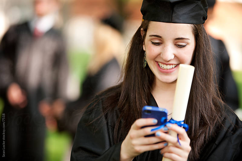 Graduation: Girl Texting Good News to Relatives by Sean Locke for Stocksy United