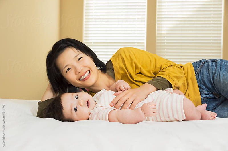 Portrait of Asian mother and baby girl by yuko hirao for Stocksy United