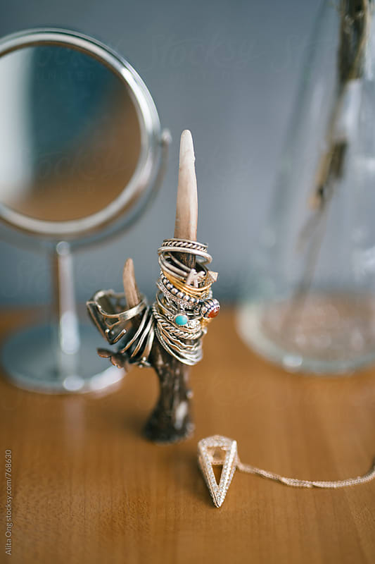 Close up shot of rings collection on dressing table by Alita Ong for Stocksy United