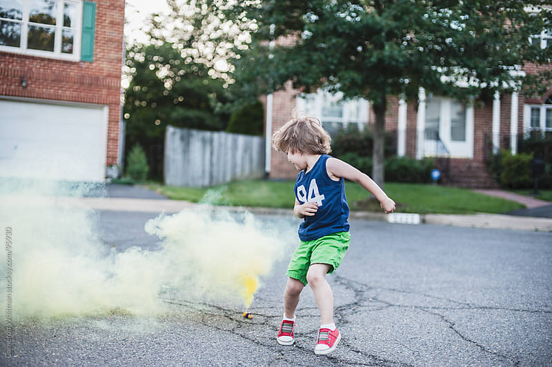 Young Boy Jumping Smoke Bombs by Cameron Whitman for Stocksy United