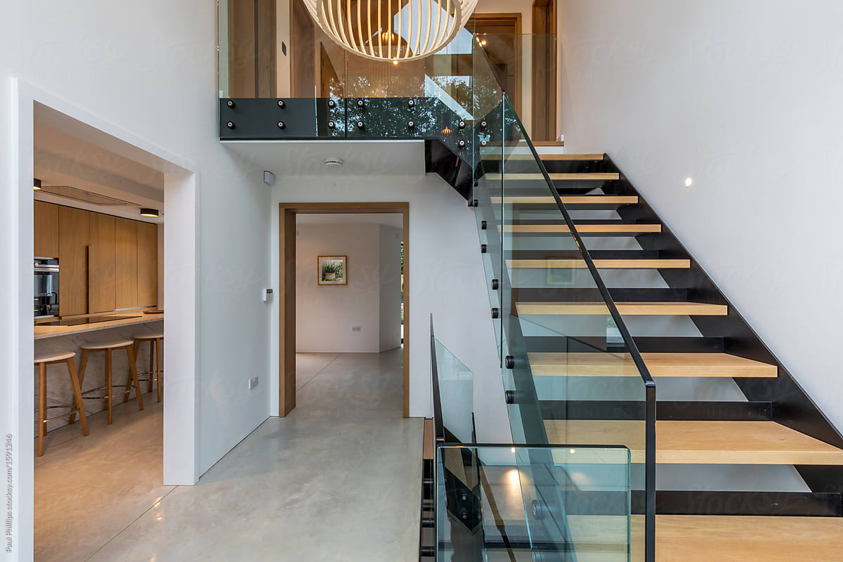 Entrance hall of a modern house with views of staircase kitchen and hall