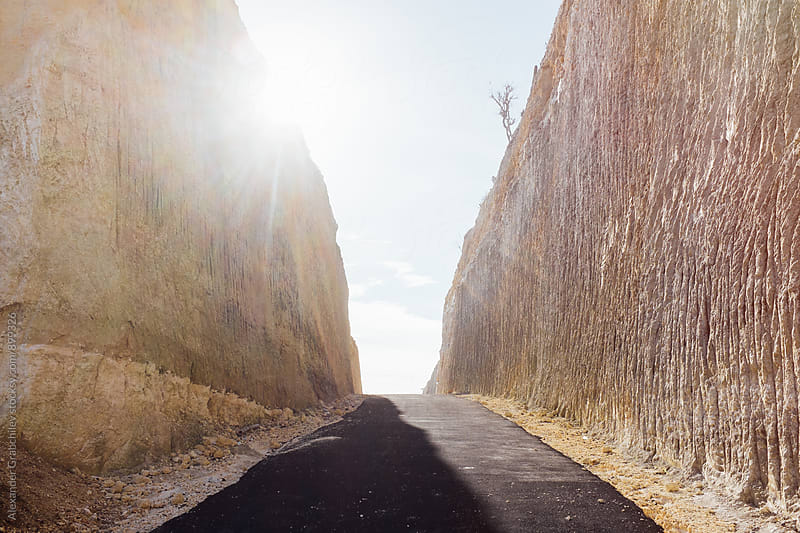 Road Between Rock Walls by Alexander Grabchilev for Stocksy United