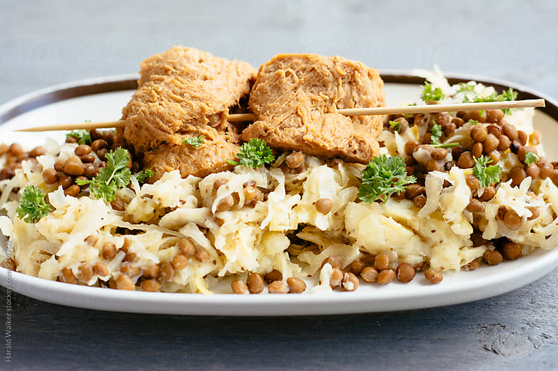 Mashed potatoes, Sauerkraut and Lentils with TVP Medallions by Harald Walker for Stocksy United