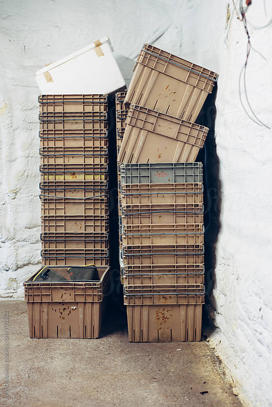 Empty crates by John Dunaway for Stocksy United