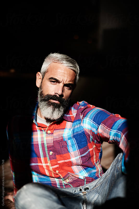 handsome and serious bearded man by Guille Faingold for Stocksy United