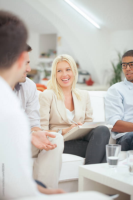 Smiling Business People Chatting by Lumina for Stocksy United