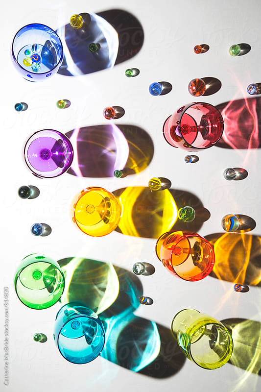 Colourful glasses and marbles... by Catherine MacBride for Stocksy United