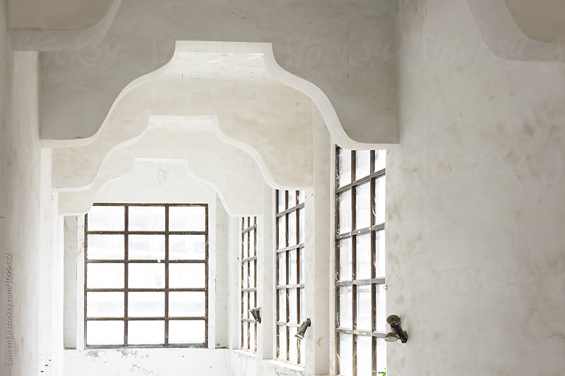 Old white room with windows by Lawren Lu for Stocksy United