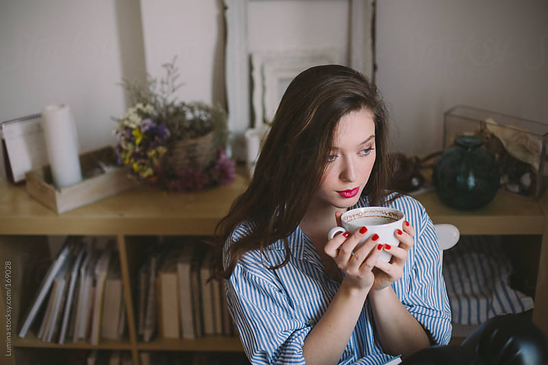 Young Woman Drinking Tea by Lumina for Stocksy United