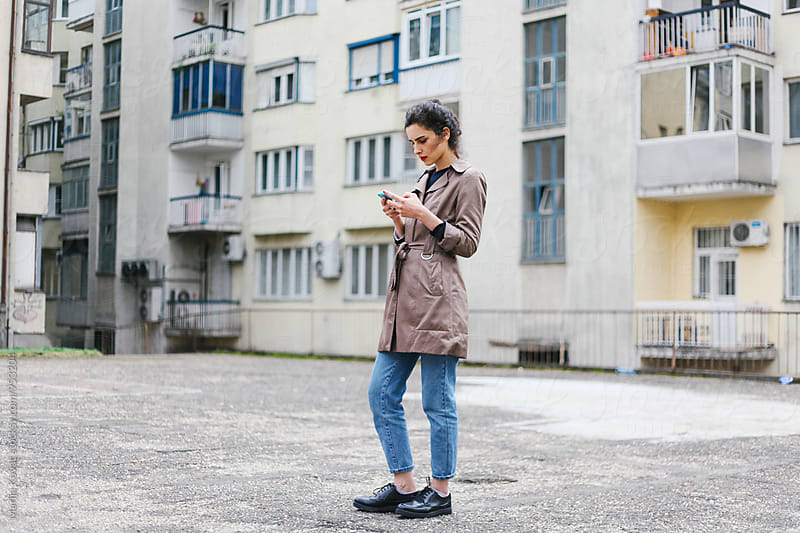 Woman browsing on a mobile phone by Marija Kovac for Stocksy United