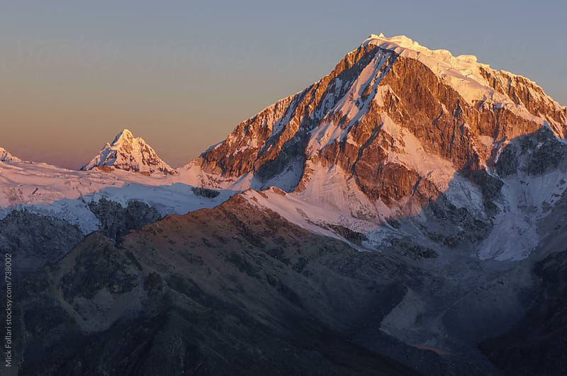 Sunset light on a high altitude peak in the Andes by Mick Follari for Stocksy United
