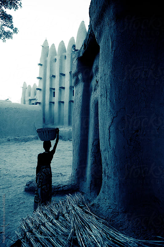 Young girl infront of Sirimou Mosque. Mali by Hugh Sitton for Stocksy United