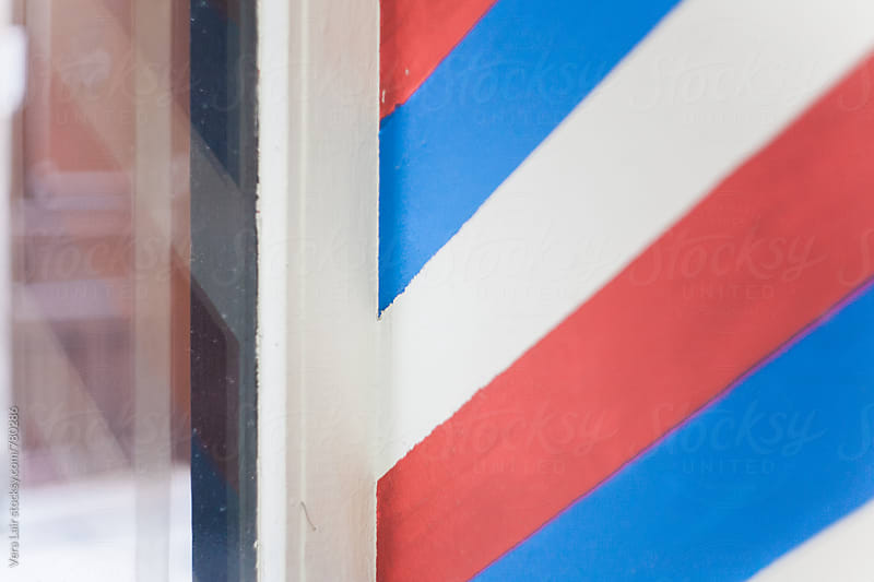 Detail of a barber shop window by Vera Lair for Stocksy United