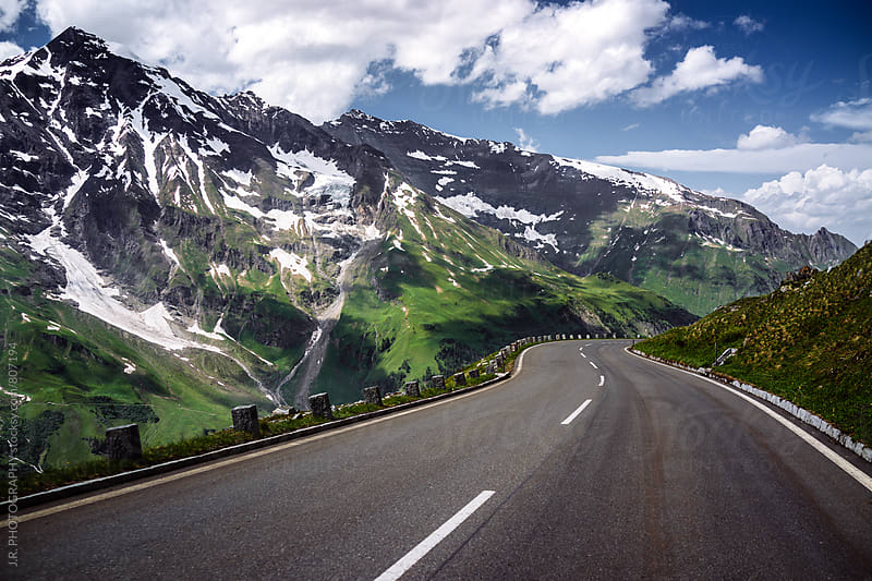 Straight road in the mountains by J.R. PHOTOGRAPHY for Stocksy United