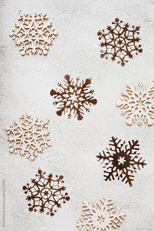 Icing sugar snowflakes by Pixel Stories for Stocksy United