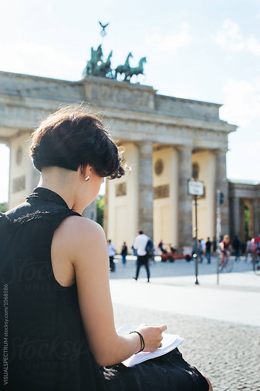 Young Artist Drawing Outdoors Near Berlin's Brandenburg Gate by Julien L. Balmer for Stocksy United