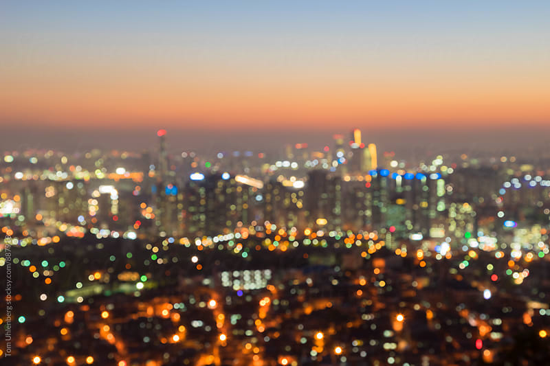 Defocused Lights of a Big City at Twilight by Tom Uhlenberg for Stocksy United