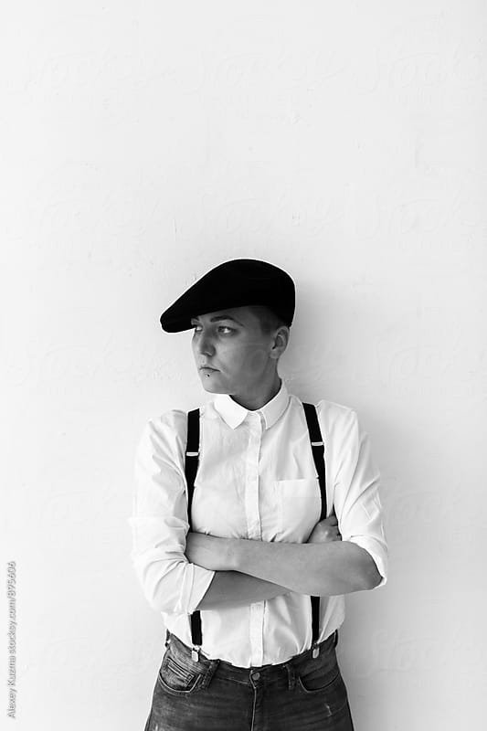 portrait of lesbian woman with black hat by Alexey Kuzma for Stocksy United