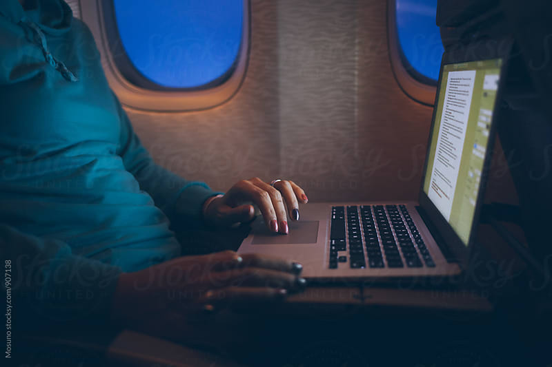 Anonymous Woman Using Laptop On an Airplane by Mosuno for Stocksy United