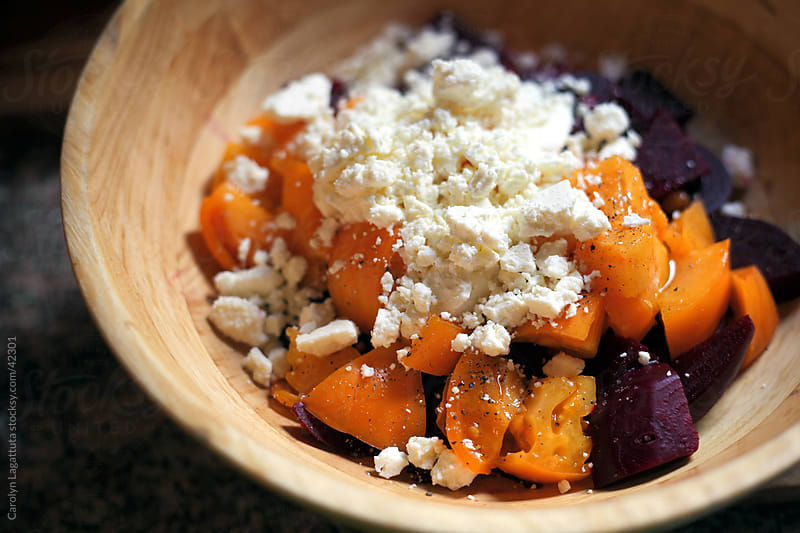 Organic beets and heirloom tomatoes with feta, olive oil and basil. by Carolyn Lagattuta for Stocksy United