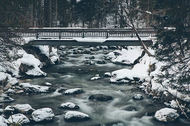 River in winter landscape by Robert Kohlhuber for Stocksy United