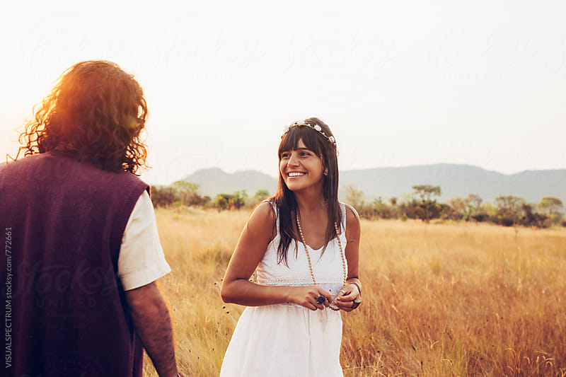 Romance - Young Hippie Couple Having Fun Together in Dry Countryside by VISUALSPECTRUM for Stocksy United
