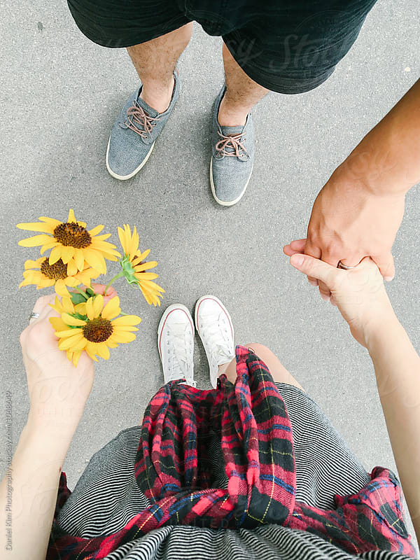 Couples feet and holding hands by Daniel Kim Photography for Stocksy United