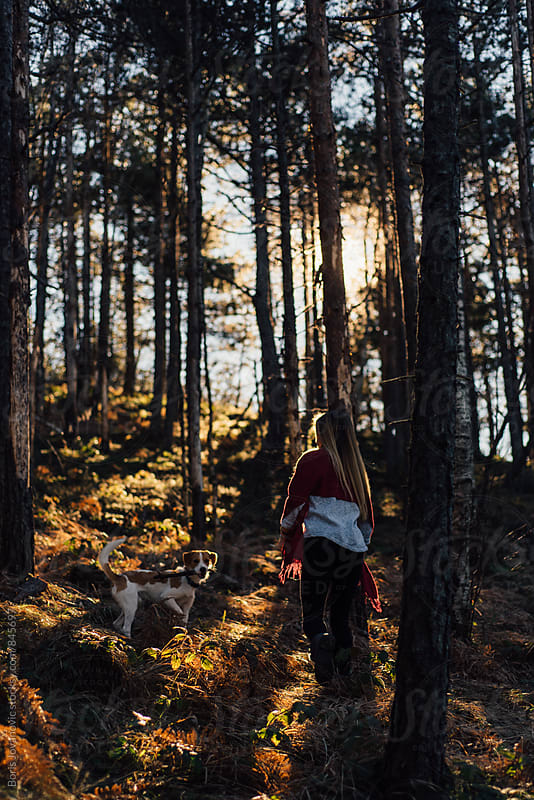 Woman having a walk through forest by Boris Jovanovic for Stocksy United