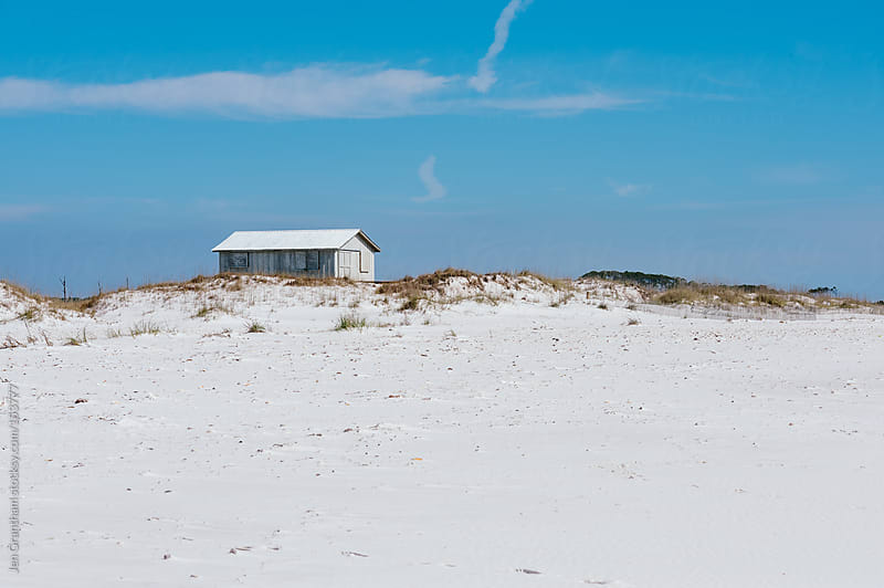 Abandoned house on a white sand beach by Jen Grantham for Stocksy United