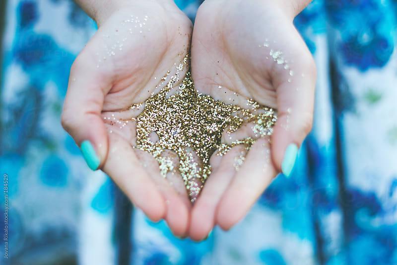Glitter in girl's hands by Jovana Rikalo for Stocksy United