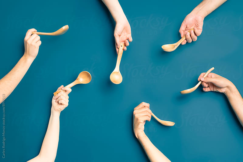 Spoon and hands composition by Carles Rodrigo Monzo for Stocksy United