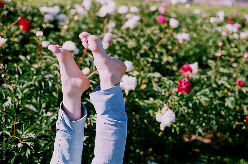 Bare feet at peony garden by Lyuba Burakova for Stocksy United