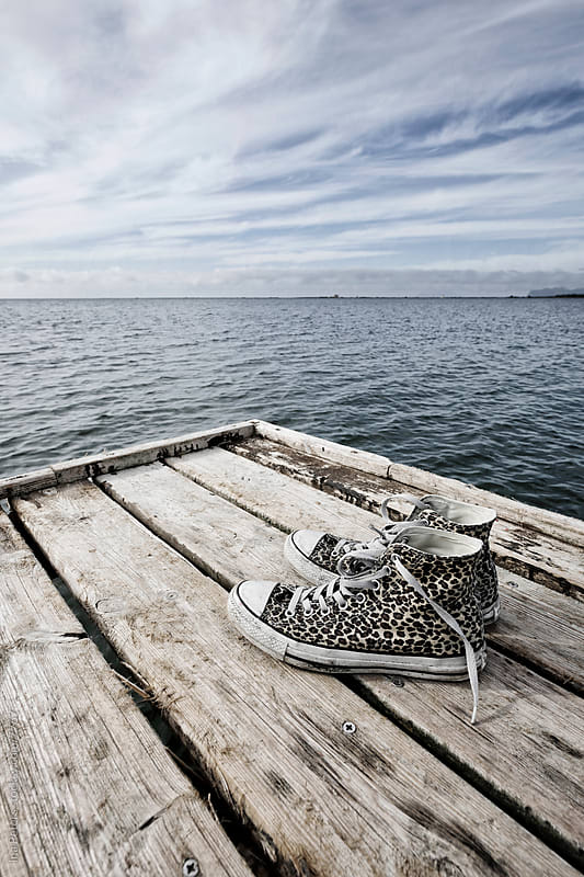 Sneakers at the sea by Ina Peters for Stocksy United