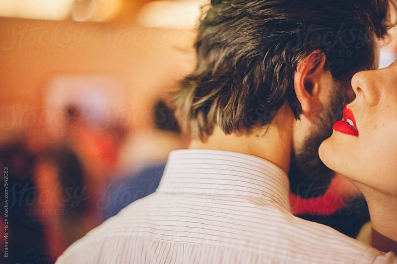 a womans red lips whispering into a mans ear by briana