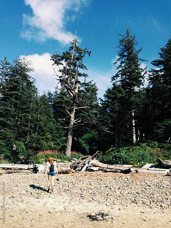 Woman Walking on Forested Beach by Kevin Russ for Stocksy United