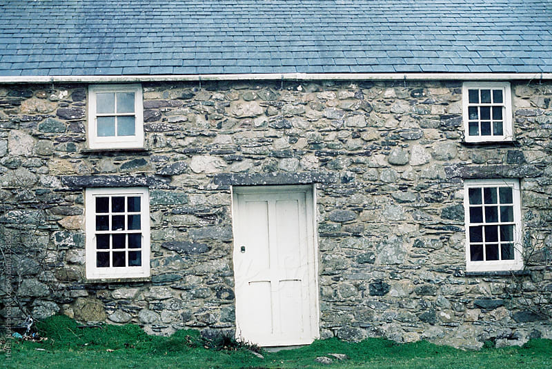 A stone cottage by Helen Rushbrook for Stocksy United