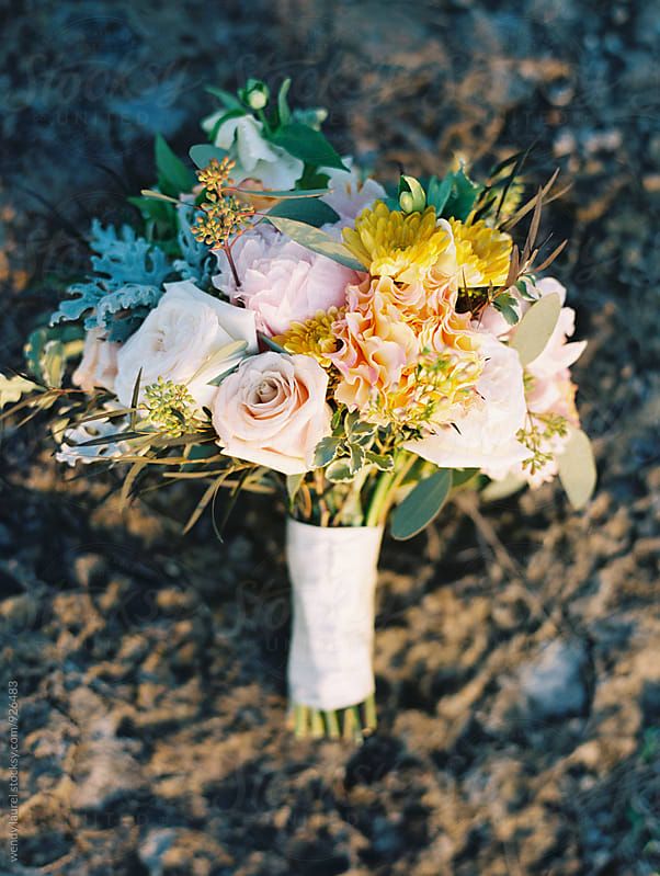 colorful wedding bouquet on rocks by wendy laurel for Stocksy United