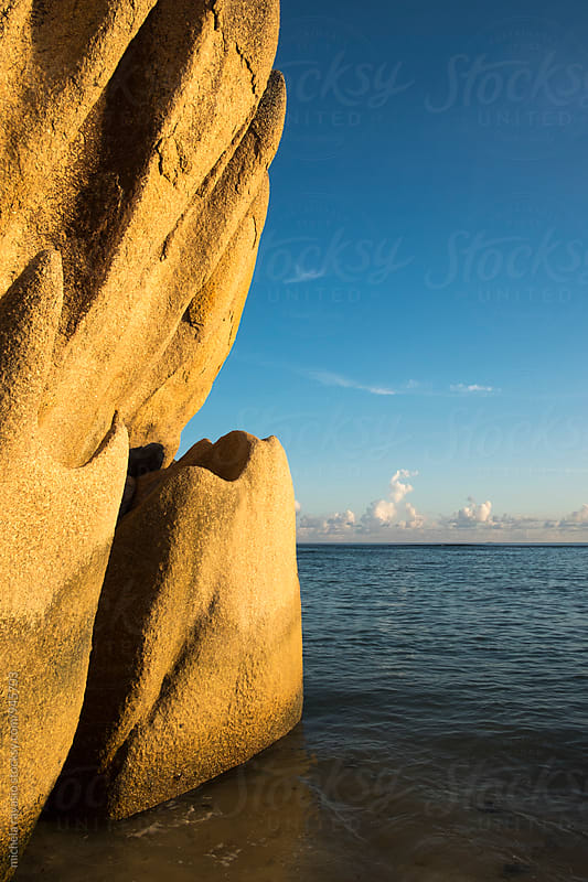 Granitic rocks lit by the sunset in La Digue by michela ravasio for Stocksy United