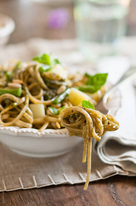 a plate of spaghetti al pesto  by Laura Adani for Stocksy United